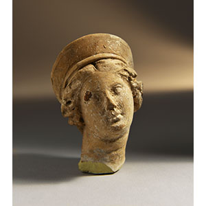 Small female head with crescent diadem