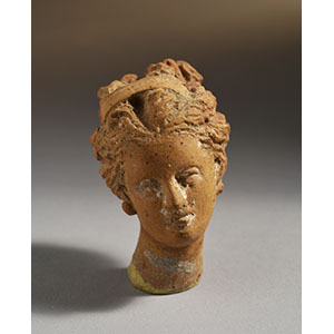 Small female head with earrings