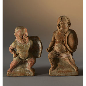Two statuettes depicting grotesque soldiers
