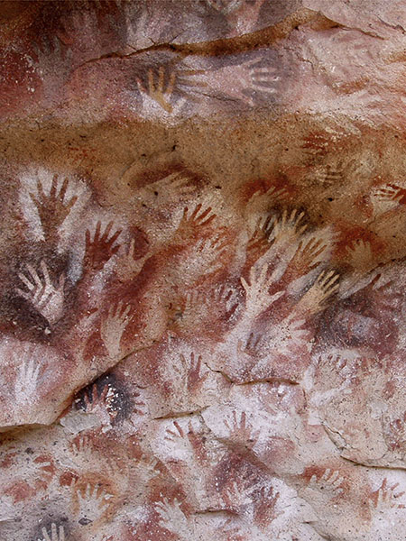 Positive and negative handprints created with red ochre or manganese dioxide. Cueva de las Manos, Argentina, 11.000-7.500 BC.