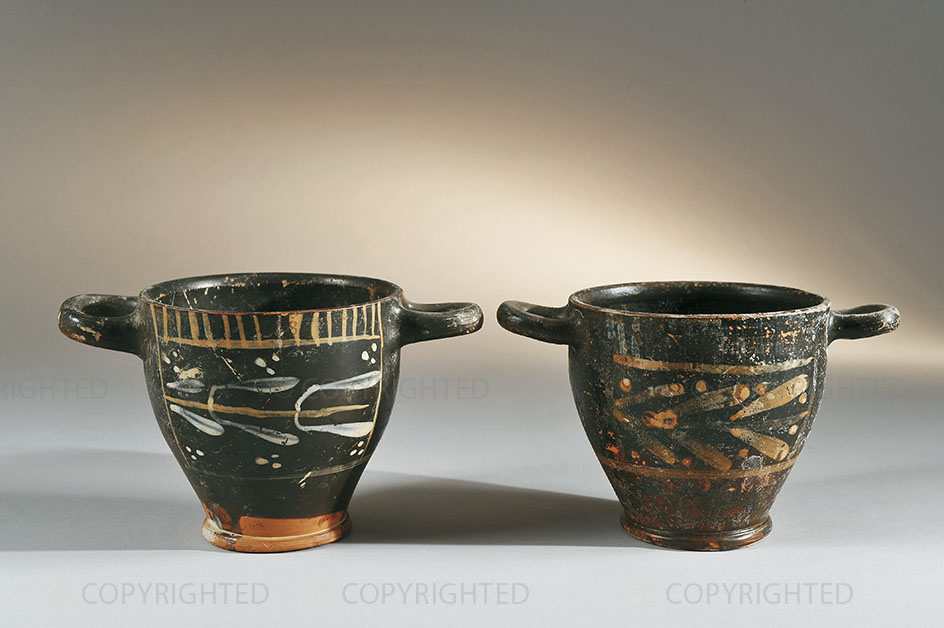Two black-painted skyphoi with overpainting decoration