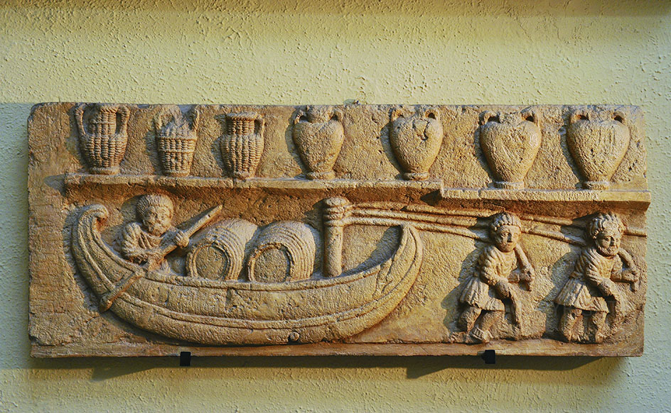Bas-relief with barge transporting barrels